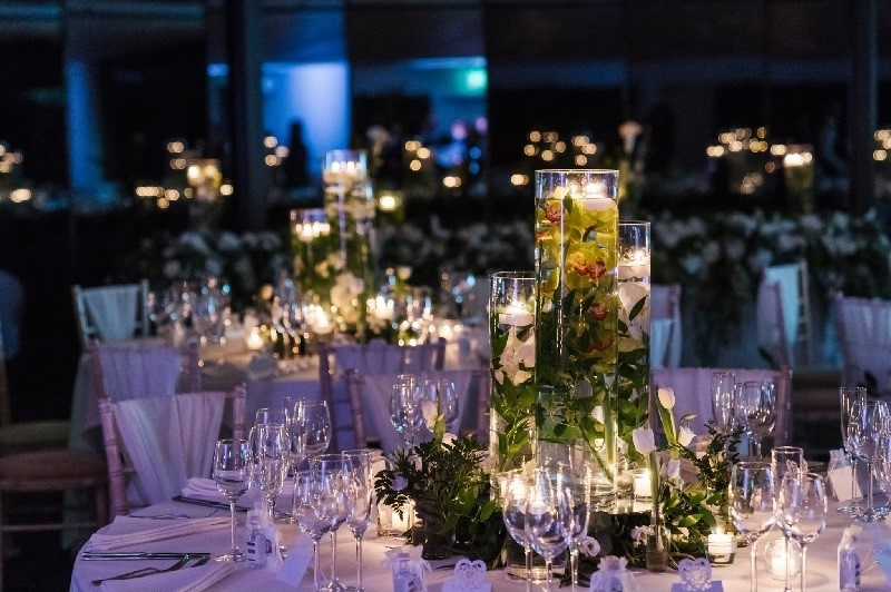 A violet themed table at a wedding reception