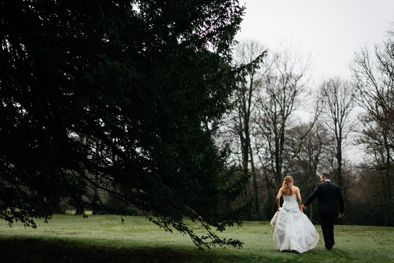 A married couple walking through the grounds at Fairyhill.